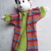 Báb József színes kabátban
